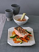 Salmon fillet with a sweet-and-sour cucumber and pumpkin medley