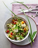 Bulgur salad with purslane, garlic chives, spring onions and redcurrant tomatoes in an apple dressing