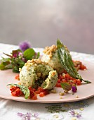 Wild herb and semolina dumplings with roasted walnut crumbs on tomato salsa with fried buckthorn