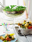 A colourful layered salad and a Mediterranean bread salad for a party buffet