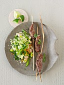 Bulgur salad with lamb fillet skewers