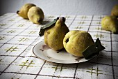 Quinces on a 1950s plate on a vintage tablecloth