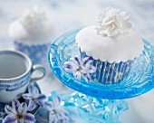 A white cupcake with a fondant flower