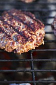 A burger on a grill