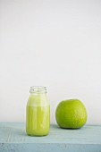 Green juice made from Granny Smith apples, limes and ginger