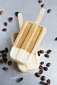 Espresso ice cream sticks surrounded by coffee beans
