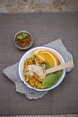 Porcini mushroom risotto with tomato pesto, orange wedges and baby spinach