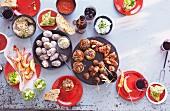 An arrangement of various Spanish tapas and dips