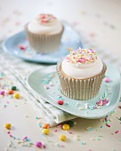 Vanilla cupcakes with coloured sugar sprinkles