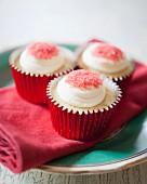 White chocolate cupcakes with red sugar sprinkles