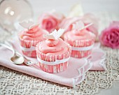 Strawberry cream cupcakes decorated with butterflies