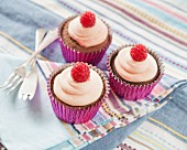 Chocolate cupcakes with raspberries