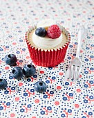 A raspberry, blueberry and banana cupcake