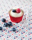 A raspberry, blueberry and banana cupcake