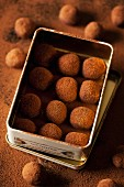Chocolate truffles in a metal tin