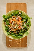 Watercress salad with crab, mango and coconut chips