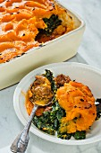 Minced emu bake with kale and a sweet potato topping