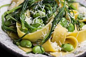 Tagliatelle with buck's horn plantain, broad beans and grated Parmesan cheese