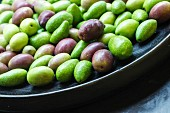 Fresh olives in a black bowl