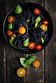 Sepia noodles with tomatoes and basil