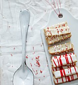 Almond thins with red and white icing