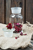 Dried rose petals in a glass jar