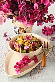 Yellow lentil salad with flowers and wild herbs