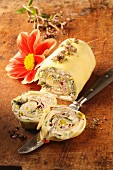 A pasta roll filled with cream cheese and edible flowers