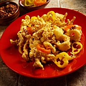 Fried squid diablo with red and yellow pickled peppers and chilli flakes