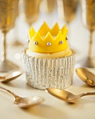 A cupcake decorated with a fondant crown