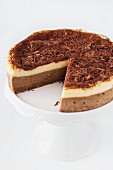 Sliced tiramisu cheesecake on a cake stand
