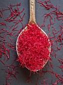 Saffron threads on a silver spoon