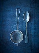 An old sieve and an antique spoon (seen from above)