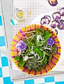 A wild salad with purple potato crisps