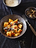 Pumpkin gnocchi with sage and grated Parmesan cheese