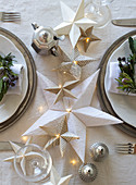 Handmade origami Christmas stars on table