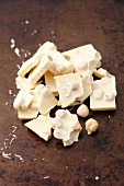 Broken white chocolate with hazelnuts