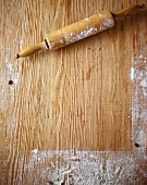 A floured wooden work surface and a rolling pin