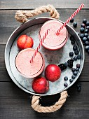 Fresh smoothies with nectarines, blueberries and blackberries