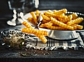 Crinkle-cut chips in a metal dish