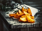 Country potatoes with rosemary in a paper bag