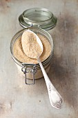 Breadcrumbs in a jar with a spoon