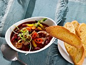 Beef stew with kidney beans and peppers