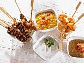 Meat, poultry and prawn skewers with dips