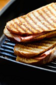 Grilled ham and cheese paninis
