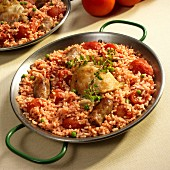 Paella with chicken, sausage and tomatoes