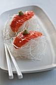 Salmon sashimi on radish strips with wasabi