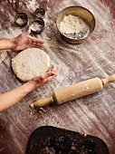 A person making scones: rolling out pastry
