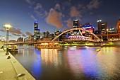 An open-air bar under the pedestrian bridge over the Yarra River, downtown Melbourne, Australia