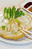 Asparagus tips with pearl oysters, Chinese dish from the Flower Drum restaurant, Melbourne, Australia